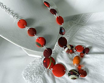 Long necklace in orange and green fabrics, with terracotta beads and glass