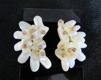 Goldtone and white earrings in an organic shape