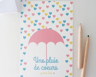 Illustrated postcard of yellow, blue and pink hearts
