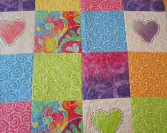 Crib or lap quilt with colorful hearts; rainbow of color, boda be designed fabric