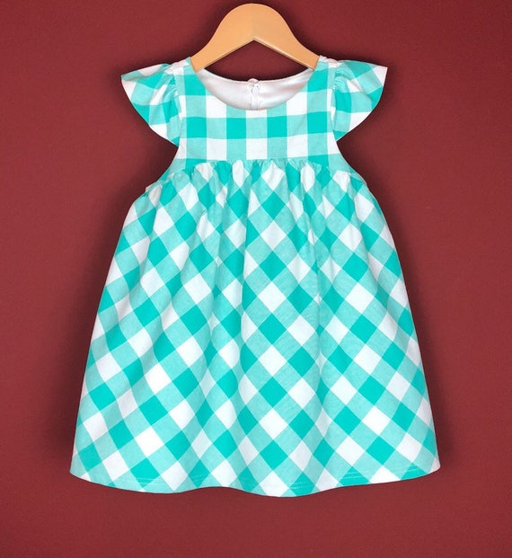"The ""Flutter-By Dress"" in Aqua Gingham."