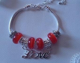 "Charm's orange charm bracelet with ""love"" ref 330"