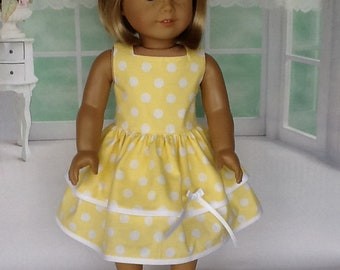 18 inch doll dress and hair clip. Fits American Girl Dolls. Yellow and white ruffled dress.