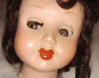 Vintage doll head with sleepy eyes and fine wig hair