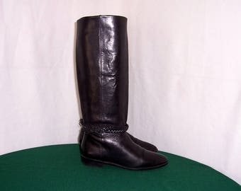 Sz 6 Vintage tall black leather 1980s women Unisa flat riding boots with braided ankle straps.
