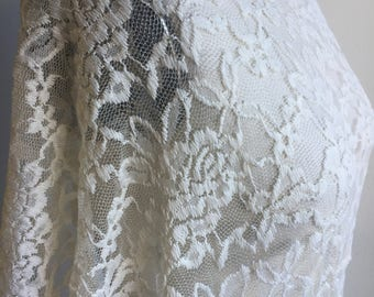 Ivory Floral Stretch Lace Knit Fabric. Designer End Bolt