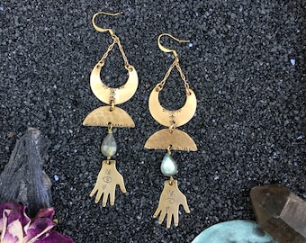 Deep Space earrings |  Brass crescents with labradorite crystals, hand, eye