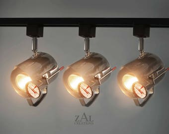 Track Lighting Fixture, Stainless steel Frothing Cafe Pitcher. 3 Track lights and Track.