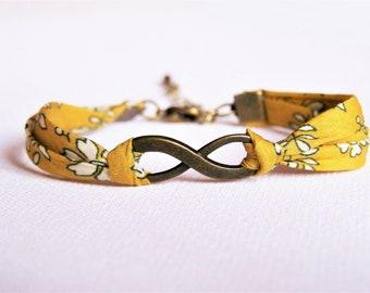 Mustard yellow floral infinity bracelet