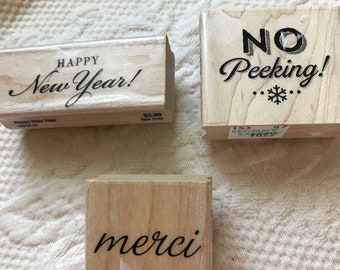 3 assorted Rubber Stamps Christmas New Years and Merci  Brand New