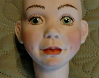 A True Original One Of A Kind Porcelain Bisque Doll Head. The Only One In Existence. OOAK