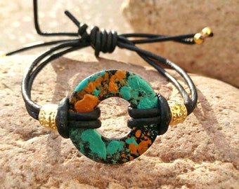 Hand painted washer bracelet with black leather adjustable cord.