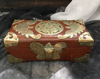 Very old copper-carved mahogany box.