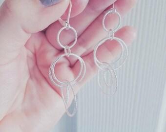Silver earrings by Anne Klein