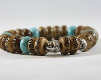 Turquoise bone boho style bracelet with a metal Buddha head. Casual wear,meditation.yoga