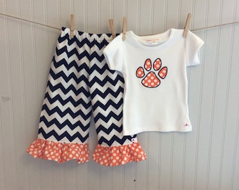 AUBURN CHEVRON PANT set - ruffled pants with applique tee in 3 sleeve types.Navy chevron with orange polka ruffle and matching tiger paw top
