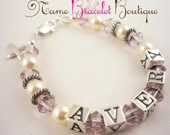 Customize this Girl's Bracelet for Baptism with cross charm with her name and birthstone or favorite colors and her size or age