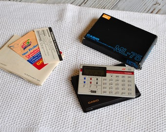 Vintage CASIO ML-75 Basaic Calculator Clock Alarm Melody.Very Rare.made in JAPAN from 1980s