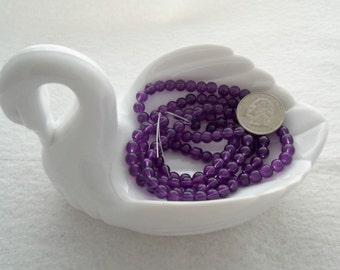 M* - Strand of Translucent 6 mm Glass Beads  (1706)