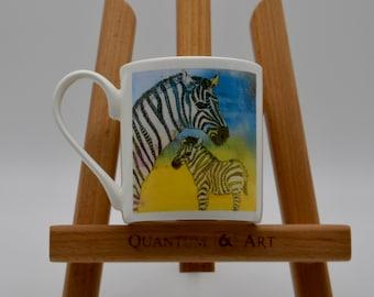 A vibrant, colourful bone china mug featuring a zebra and foal, original artwork