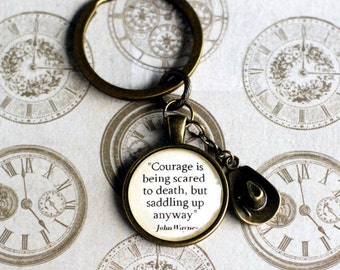 "John Wayne quote ""Courage is being scared to death, but saddling up anyway"" KEYCHAIN pendant with cowboy hat"