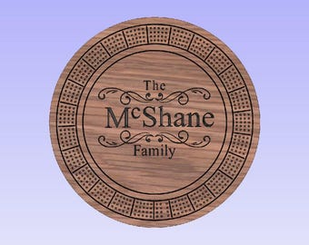 Custom round cribbage board personalized with your family name.