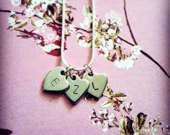 Hand stamped love heart necklaces