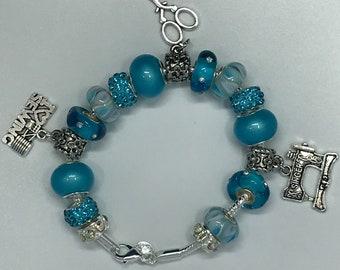 Sewing themed charm bracelet in Aqua