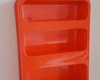 orange plastic wall shelf