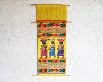 Vintage Mid Century Woven Wall Tapestry with Indigenous Women. Circa 1960's.