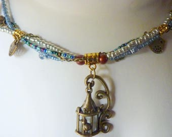NECKLACE * FREE BIRD * Blue Metallic green jeans with bronze flower clasp