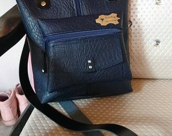 Stylish blue hand and shoulder bag