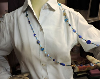 Long Necklace in shades of Blue with Gold Metal Accent ...  about 40 inches long
