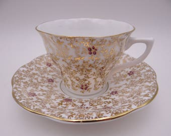 Vintage English Staffordshire Bone China Gold Chinz Footed Teacup and Saucer