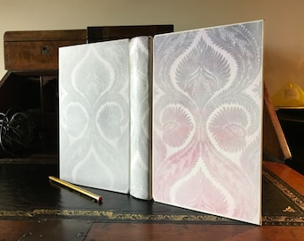 Vellum bound journal / diary bound with Arches handmade paper pages and a bespoke painted design under the parchment leather