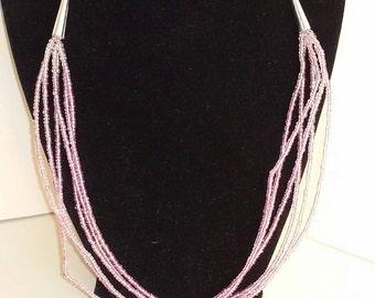 6 strand light pink necklace