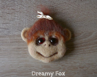 Needle felted monkey magnet.