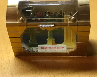 Vintage New York City treasure chest snow globe with world trade center, liberty, empire state bldg