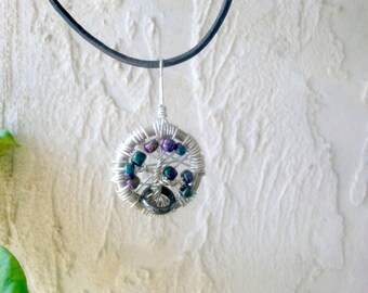 Beaded tree of life wire wrapped pendant.