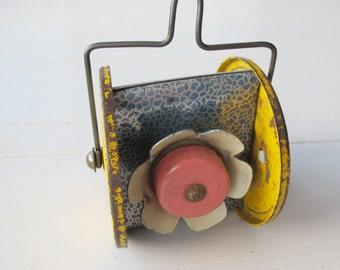 Vintage tin pull-along toy. Flower bells!
