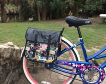 Bicycle pannier, semi-waterproof, cotton print with nylon lining.  Vinyl overflap, and back.