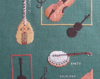 """Embroidery """"the ropes"""" cross stitch on green background"""