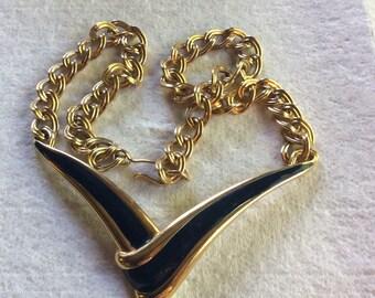 Vintage Monet navy blue enamel on metal v pendant necklace .