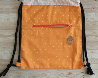 Backpack. Orange with dots