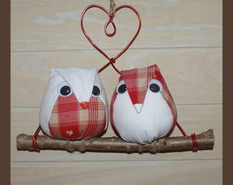 owls fabric on a branch of wood