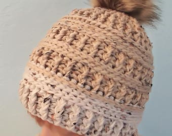 Textured crochet hat with faux fur pom pom