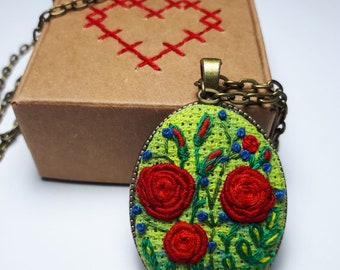 Embroidery pendant with red flowers in frame