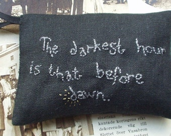 Lavender sachet in black linen with embroidered text The darkest hour is that before dawn
