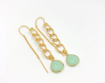 Handcrafted thread dewdrops with pale blue glass stone.