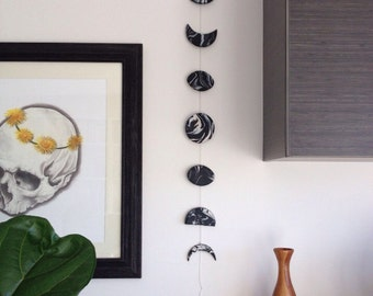 Phases of the moon clay wall hanging